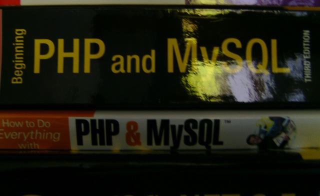 "1300 page long ""Beginning PHP and MySQL"", 200 page long ""How to do everything with PHP & MySQL"""